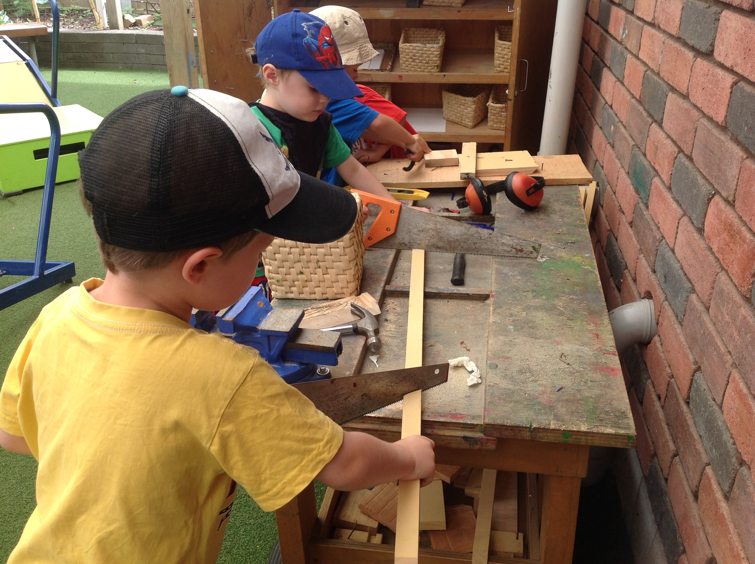 young children at carpentry play