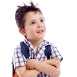 Pensive school kid looking up, isolated on white background